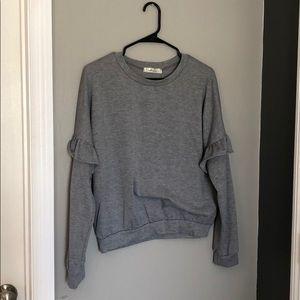 Grey sweater with sleeve ruffle